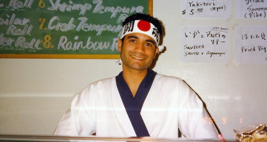 Mr. Black as head sushi chef at age 22, wearing a bandanna that says Fighting Tiger in Japanese