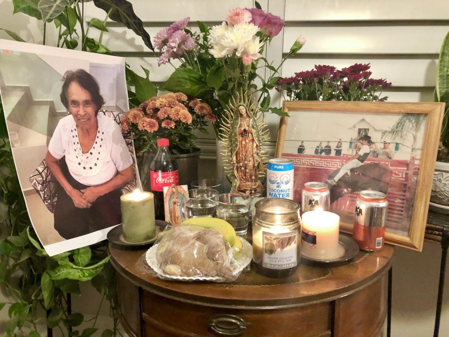 Senior Nayeli Mendoza celebrates Day of the Dead with an ofrenda for lost loved ones.